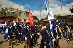 Latino Students Marching. Students march in a Independence Day Parade in Diriamba, Nicaragua celebrating the independence of Central America from Spain. The Royalty Free Stock Photos