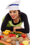 Latino woman chef with vegetables Stock Photo