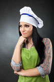 Latino woman cook thinking Stock Images