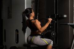 Latino Woman Doing Exercise For Back On Machine Stock Photography