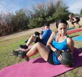 Latino Woman Doing Sit-Ups Stock Photography