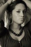 latino woman has hoop earings Royalty Free Stock Image