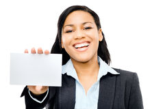Latino woman holding white card background Stock Images