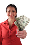 Latino Woman with Money. A stock image of a smiling Latino woman holding money in her clenched fist. Isolated on white Stock Photography