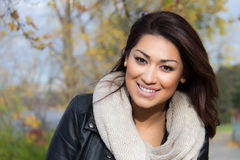 Latino woman outdoors during autumn Stock Photos