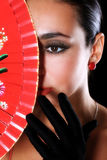 Latino woman with red fan and Royalty Free Stock Image