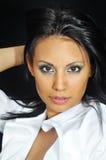 Latino woman wearing white top Stock Photography