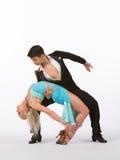 Latinska balsaldansare med blåttklänningen - tillbaka krökning Royaltyfri Fotografi