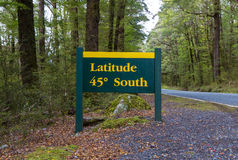 Latitude 45 degree road signs in Te Anau-Milford Highway, Fiordland National Park, New Zealand Royalty Free Stock Photos