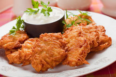 Latke, potato pancake with sour cream Stock Image
