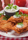Latke, potato pancake with sour cream Royalty Free Stock Photos
