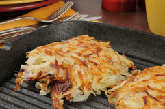 Latkes in a cast iron skillet Stock Images