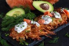 Latkes with cream cheese and salmon Stock Photo