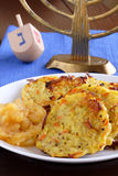 Latkes and dreidel Stock Image