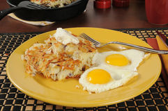 Latkes and fried eggs Stock Photography
