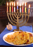 Latkes and menorah Stock Photo