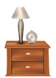 Lato del letto con una lampada e un vecchio orologio Fotografie Stock Libere da Diritti