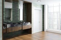 Sfuocatura interna del bagno di lusso bianco e verde smeraldo