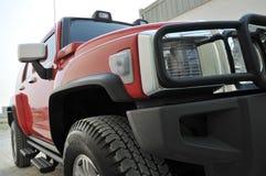 Lato rosso del Hummer H3 Fotografie Stock Libere da Diritti