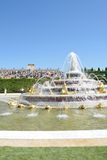 Latona  fountain at Versailles Palace with crowd in background in portrait aspect. VERSAILLES PARIS FRANCE 6 JUNE  2015: Latona  fountain at Versailles Palace Royalty Free Stock Photos