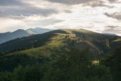 Latrigg in the Lake District shows its ascent path in the evening light Royalty Free Stock Image
