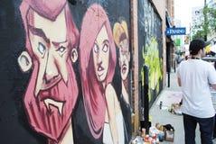 Latta di spruzzo dei graffiti & dell'artista Immagini Stock