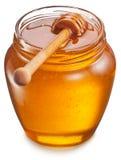 Latta di vetro in pieno di miele Percorsi di ritaglio Fotografie Stock