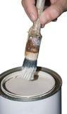 Latta, spazzola e mano della vernice Immagine Stock