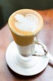 Latte на деревянной таблице Стоковые Фотографии RF
