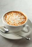 Latte. A cup of hot latte with caramel Royalty Free Stock Photos