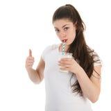 Latte alimentare della giovane donna Immagini Stock Libere da Diritti
