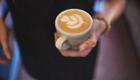 Latte art by barista focus in milk and coffee Royalty Free Stock Images