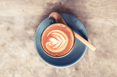 Latte art, Blue coffee cup on gray background Stock Photos