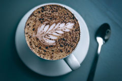 Latte art on cappuccino Royalty Free Stock Photography