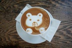 Latte art cartoon bear face of hot cappuccino coffee Stock Photos