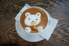 Free Latte Art Cartoon Bear Face Of Hot Cappuccino Coffee In Coffee Shop Stock Photos - 140639573