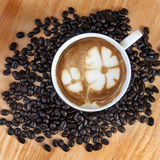 Latte art and coffee beans Royalty Free Stock Images