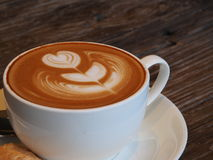Latte art coffee and biscuit Royalty Free Stock Photos