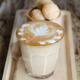 Latte art coffee and candy eggs swan Royalty Free Stock Photo