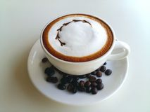 Latte art coffee with coffee bean so delicious on white. Mocha coffee with coffee bean so delicious on white Stock Images