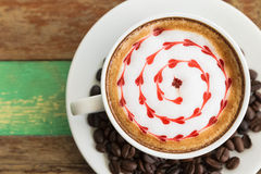Latte art, coffee with coffee beans Royalty Free Stock Images