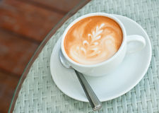 Latte art on a coffee cup Stock Photo