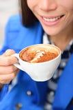 Latte art coffee cup hand closeup - woman drinking Stock Photos