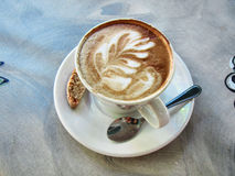 Latte-art coffee cup, teaspoon and brownie Royalty Free Stock Image