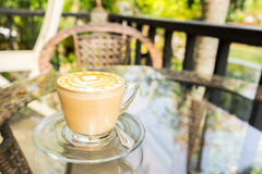 Latte art coffee cup in white mug on a table. Outdoor Royalty Free Stock Photos