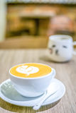 Latte art coffee with cute coffee cup Stock Image
