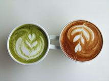 Latte art coffee and matcha latte so delicious on white. Latte art coffee with matcha green tea so delicious on white Stock Photos