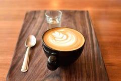 Latte art in coffee shop, Hot coffee stock photo