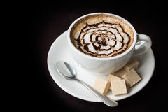 Latte art coffee with sugar Royalty Free Stock Photo