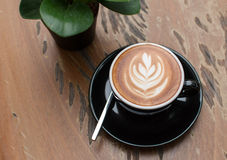 Latte art coffee. On wooden table Royalty Free Stock Photos